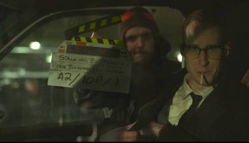 """Callam Rodya as Roddy with 3rd AD Alex Pitzel slating the shot on the set of """"Stalking by Numbers""""."""